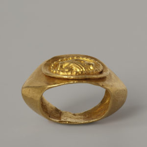 A Gold Finger Ring with Clasped Hands