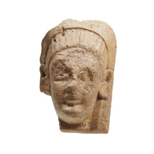 A terracotta female head antefix
